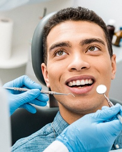 dentist examining a patient's mouth