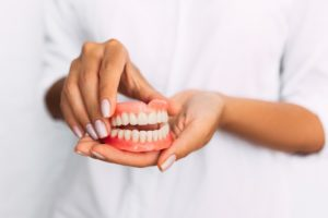 Replacement teeth needing denture adhesive
